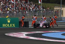 Marshals recover the car of Race retiree Esteban Ocon, Force India VJM11