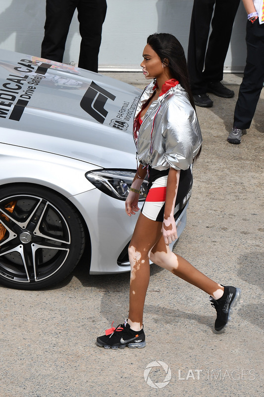 Winnie Harlow, prepares to wave the chequered flag