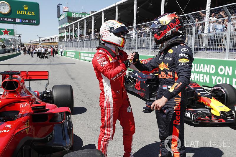 Peraih pole, Sebastian Vettel menyalami Max Verstappen