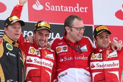 Podium: race winner Fernando Alonso, Ferrari, second place Kimi Raikkonen, Lotus F1, and third place Felipe Massa, Ferrari, Stefano Domenicali, Ferrari General Director
