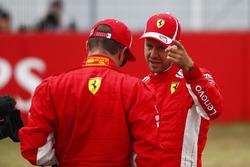 Pole sitter Sebastian Vettel, Ferrari, talks to Kimi Raikkonen, Ferrari