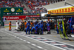 The Toro Rosso pit crew get ready for a stop