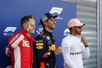 Pole setter Daniel Ricciardo, Red Bull Racing, celebrates with Sebastian Vettel, Ferrari, and Lewis Hamilton, Mercedes AMG F1