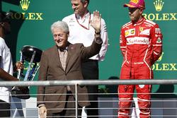 Former US President Bill Clinton alongside Second place Sebastian Vettel, Ferrari, on the podium