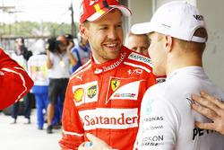 Sebastian Vettel, Ferrari, Valtteri Bottas, Mercedes AMG F1, after the session