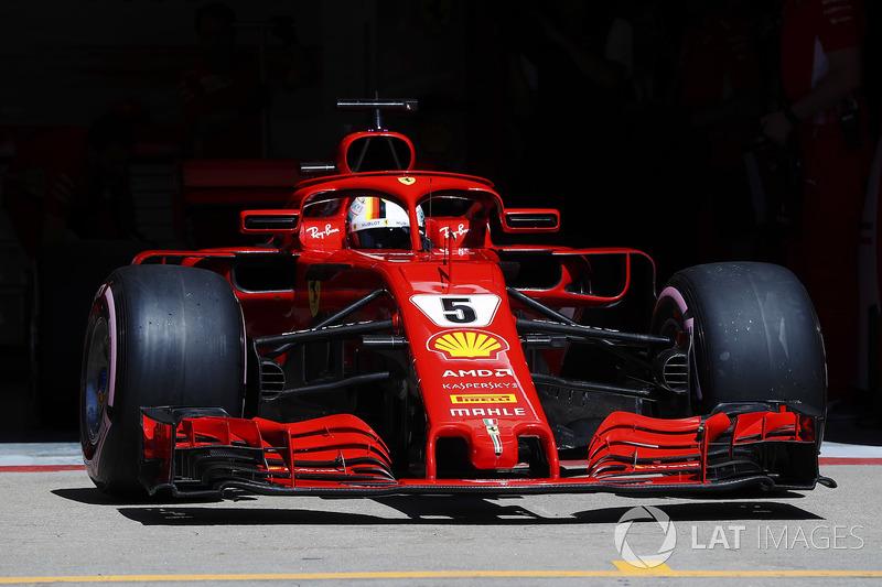 Sebastian Vettel, Ferrari SF71H, exits his pit garage