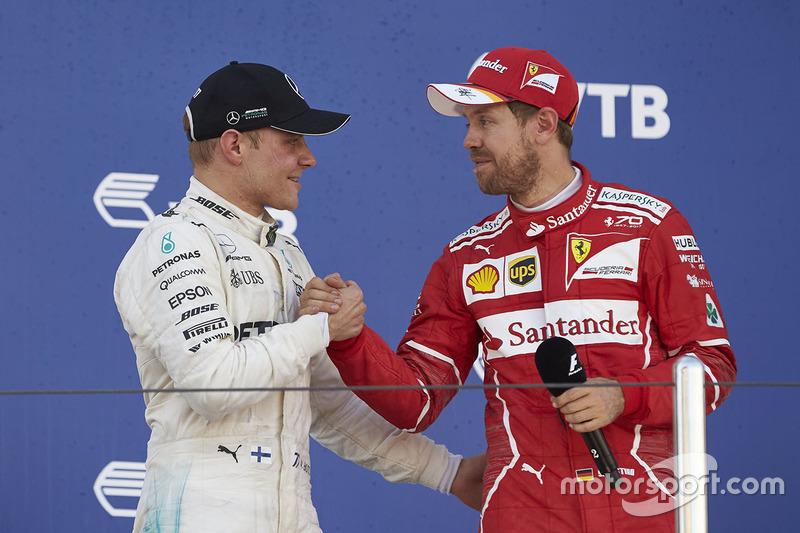 Second place Sebastian Vettel, Ferrari, congratulates Race winner Valtteri Bottas, Mercedes AMG F1