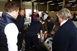 Nico Rosberg and Keke Rosberg watch Felipe Massa, six-wheeled Williams FW08
