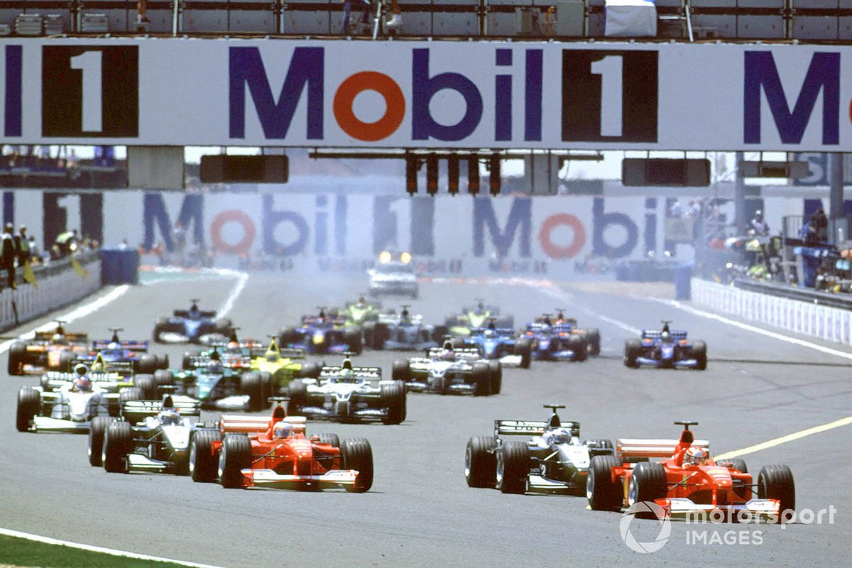 Michael Schumacher, Ferrari F1-2000 leads David Coulthard, McLaren MP4/15 Mercedes, at the start