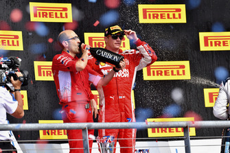 (L to R): Carlo Santi, Ferrari Race Engineer and Kimi Raikkonen, Ferrari celebrate with the champagne on the podium