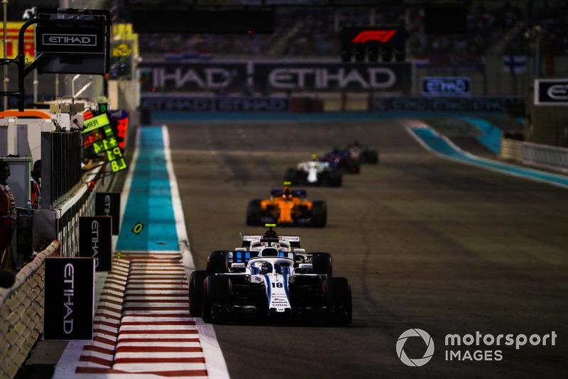 Lance Stroll, Williams FW41, leads Charles Leclerc, Sauber C37, and Stoffel Vandoorne, McLaren MCL33