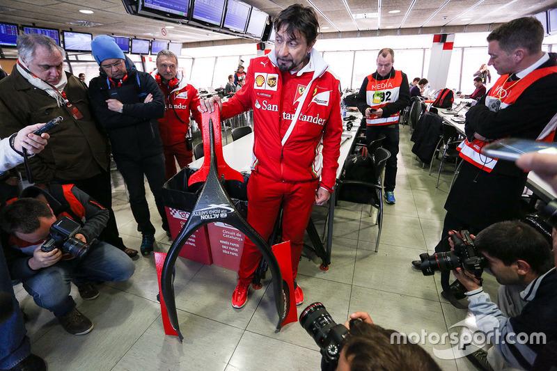 Alberto Antonini, Ferrari Press Officer discusses the Halo cockpit cover to the media