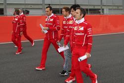 Sebastian Vettel, Ferrari walks the track, Riccardo Adami, Ferrari Race Engineer and the team