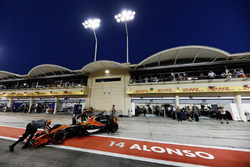 Fernando Alonso, McLaren MCL32, is returned to the McLaren garage