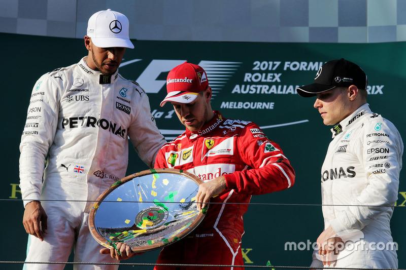 Podium : le vainqueur Sebastian Vettel, Ferrari, le second Lewis Hamilton, Mercedes AMG F1, le troisième Valtteri Bottas, Mercedes AMG F1,