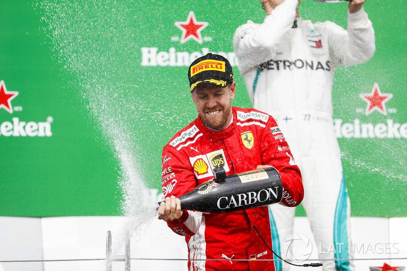 Sebastian Vettel, Ferrari, 1st position, sprays the victory Champagne
