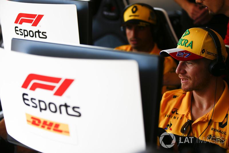 Carlos Sainz Jr., Renault Sport F1 Team, andNico Hulkenberg, Renault Sport F1 Team, try out the F1 eSports