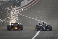 Sparks fly as Max Verstappen, Red Bull Racing RB14 Tag Heuer, battles with Lewis Hamilton, Mercedes