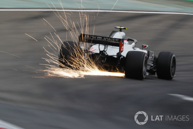 Sparks fly from the car of Kevin Magnussen, Haas F1 Team VF-18 Ferrari
