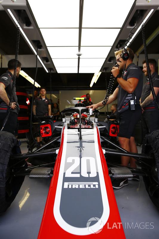 Kevin Magnussen, Haas F1 Team, in cockpit in the team's garage.