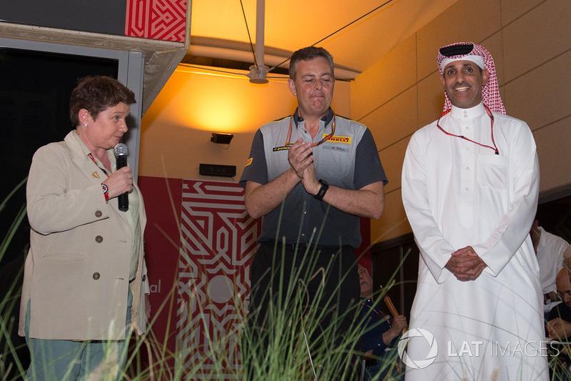 Shaikh Salman bin Isa Al Khalifa, Chief Executive of Bahrain International Circuit with Mario Isola, Pirelli Sporting Director and Kate Beavan, FOM