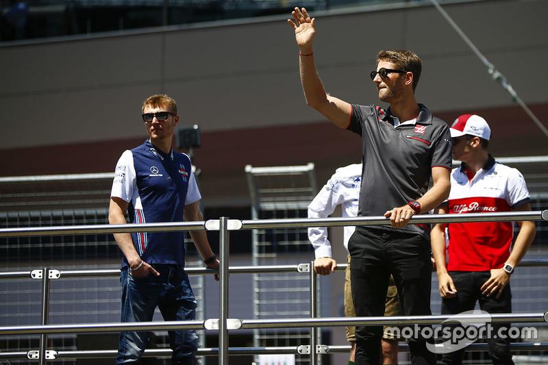 Sergey Sirotkin, Williams Racing, and Romain Grosjean, Haas F1 Team, in the drivers parade