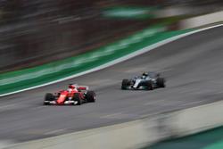 Sebastian Vettel, Ferrari SF70H and Valtteri Bottas, Mercedes-Benz F1 W08 sparks