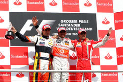 The podium: Nelson Piquet Jr., Renault second; Lewis Hamilton, McLaren, race winner; Felipe Massa, F