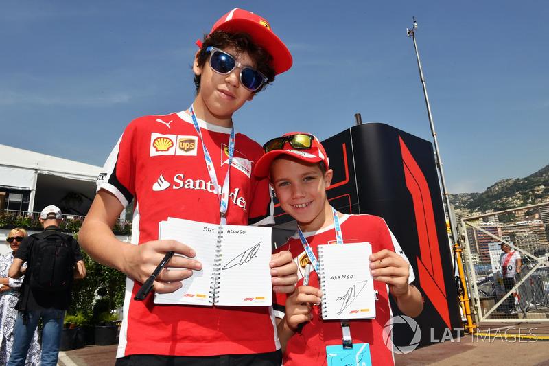 Ferrari fans with Fernando Alonso, McLaren autographs