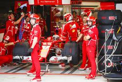 Kimi Raikkonen, Ferrari SF70H, in the Ferrari garage