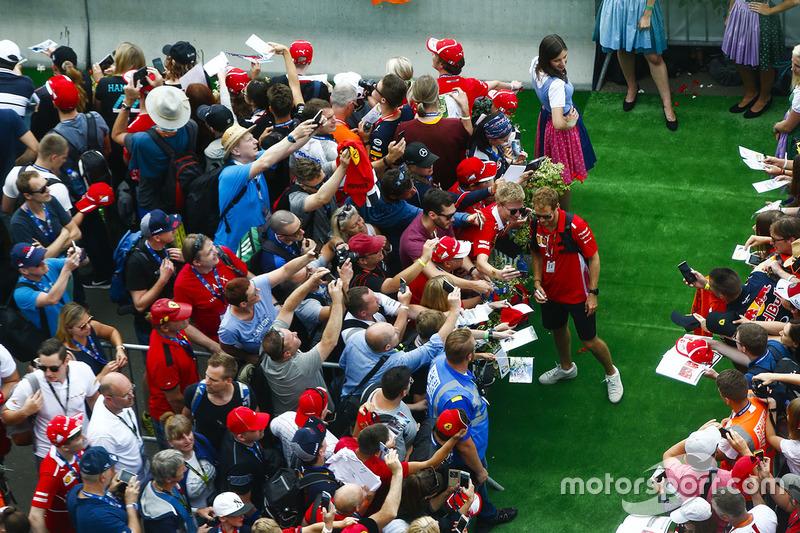 Sebastian Vettel, Ferrari, has his photo taken with a fan
