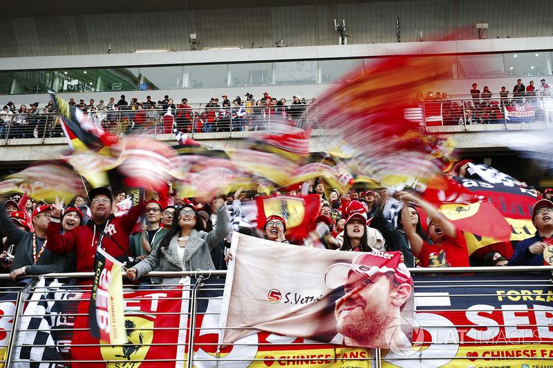 Fans of Sebastian Vettel, Ferrari, wave flags