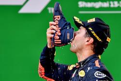 Race winner Daniel Ricciardo, Red Bull Racing celebrates on the podium with a shoey