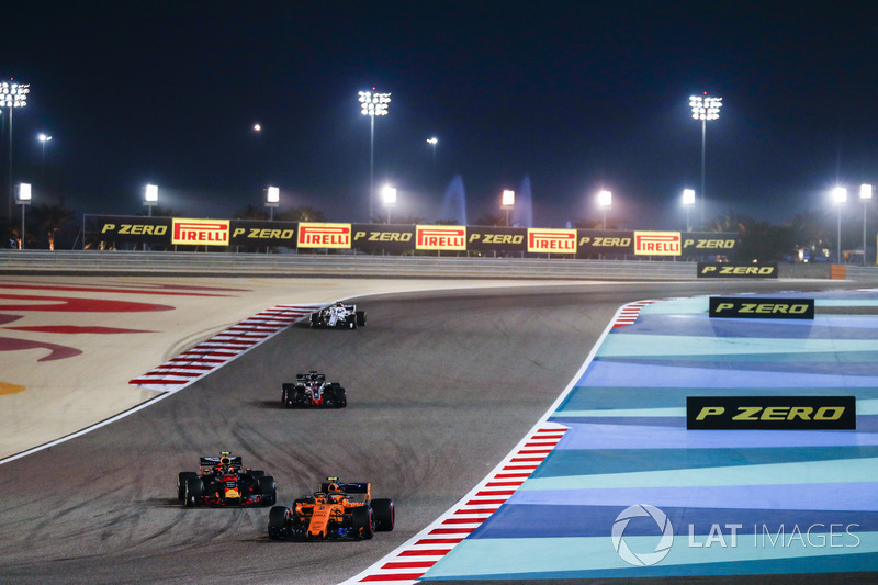 Stoffel Vandoorne, McLaren MCL33 Renault, Max Verstappen, Red Bull Racing RB14 Tag Heuer, and Romain Grosjean, Haas F1 Team VF-18 Ferrari