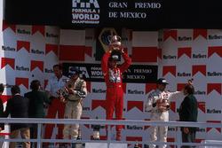 Podium: race winner Ayrton Senna, McLaren receives his Trophy