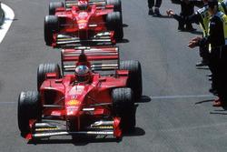 Race winner Michael Schumacher, Ferrari, second place Eddie Irvine, Ferrari