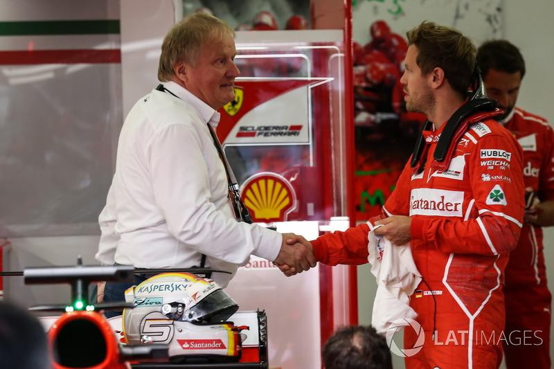 Sebastian Vettel, Ferrari and Jo Bauer, FIA Technical Delegate