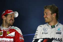 (L to R): Sebastian Vettel, Ferrari with Nico Rosberg, Mercedes AMG F1 in the FIA Press Conference