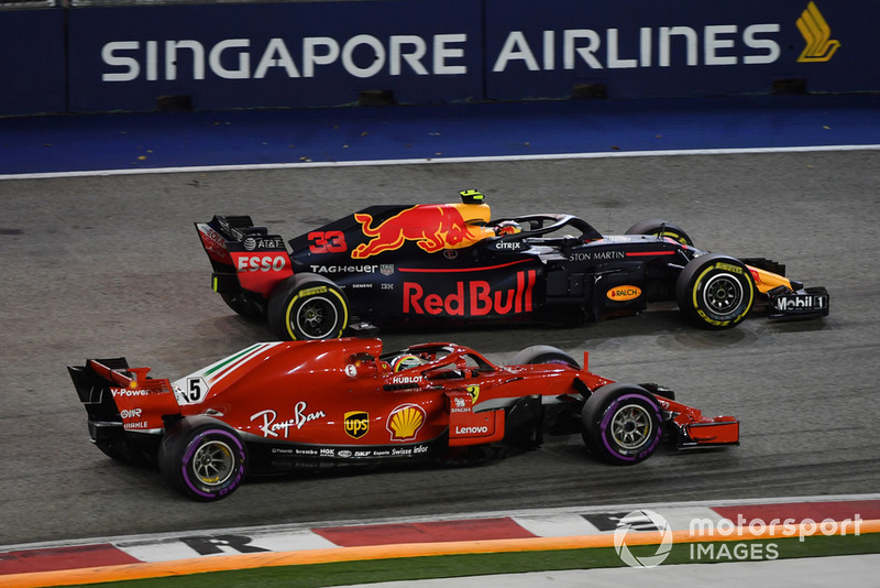 Sebastian Vettel, Ferrari SF71H fails to pass Max Verstappen, Red Bull Racing RB14 after the pitstops