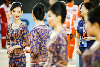 Grid girls in local costume