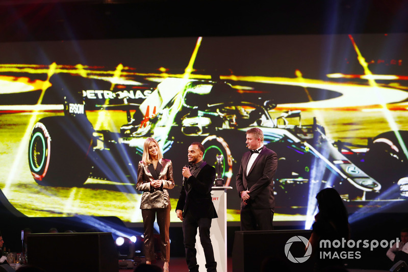 Nic Hamilton, brother of F1 World Champion Lewis Hamilton, on stage to accept the British Competition Driver and International Racing Driver awards