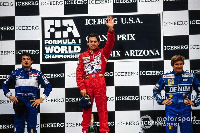 Jean Alesi, Tyrrell, 2nd position, Ayrton Senna, McLaren, 1st position, and Thierry Boutsen, Williams, 3rd position, on the podium