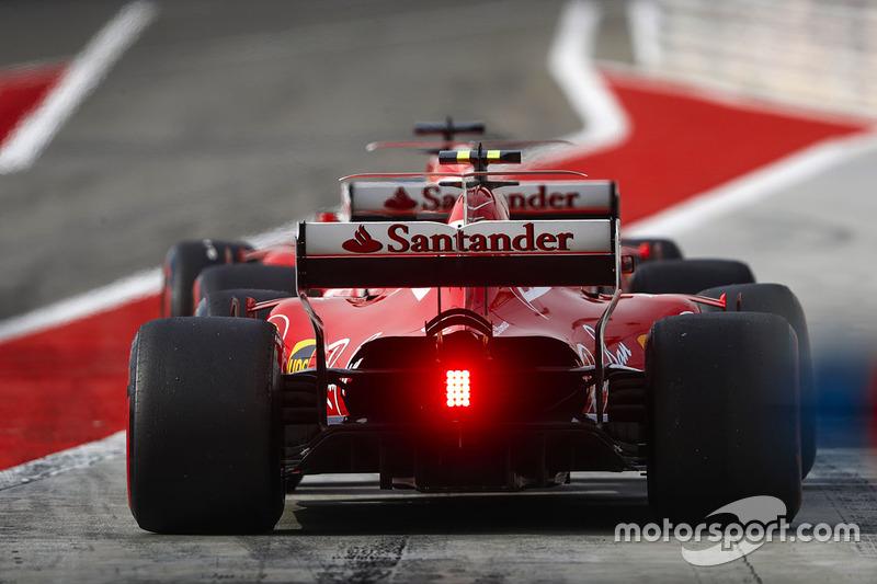 Sebastian Vettel, Ferrari SF70H, and Kimi Raikkonen, Ferrari SF70H, leave the pits