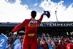 Lucas di Grassi, ABT Schaeffler Audi Sport, throws a cap to the fans