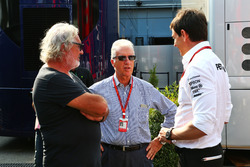 (L to R): Flavio Briatore, with Piero Ferrari, Ferrari Vice-President and Toto Wolff, Mercedes AMG F