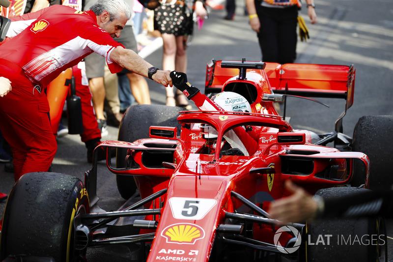 Sebastian Vettel, Ferrari SF71H, is greeted by Maurizio Arrivabene, Team Principal, Ferrari, after t