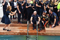 Geri Halliwell, takes a photo of Daniel Ricciardo, Red Bull Racing, Adrian Newey, Red Bull Racing at the Red Bull Racing Energy Station swimming pool