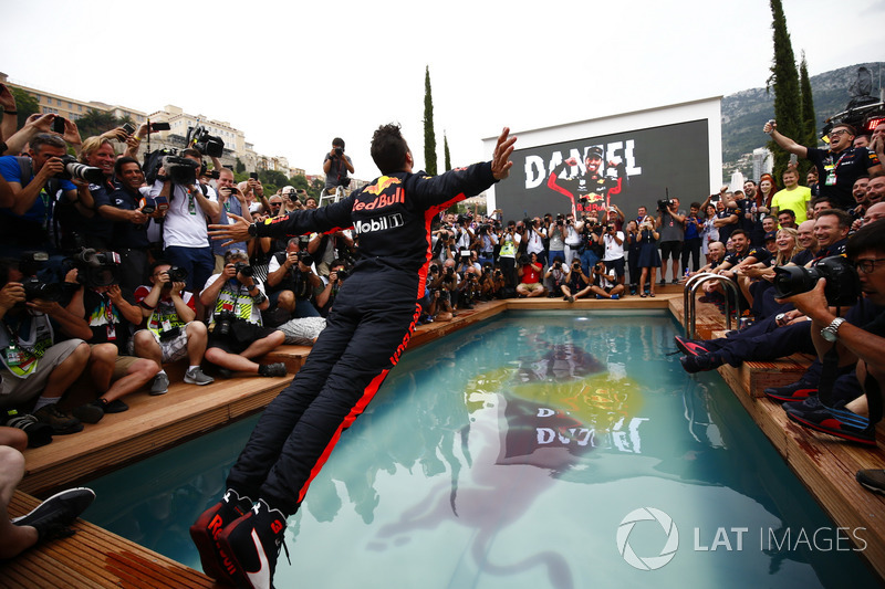 Daniel Ricciardo, Red Bull Racing, dives into the swimming pool on the Red Bull Energy Station