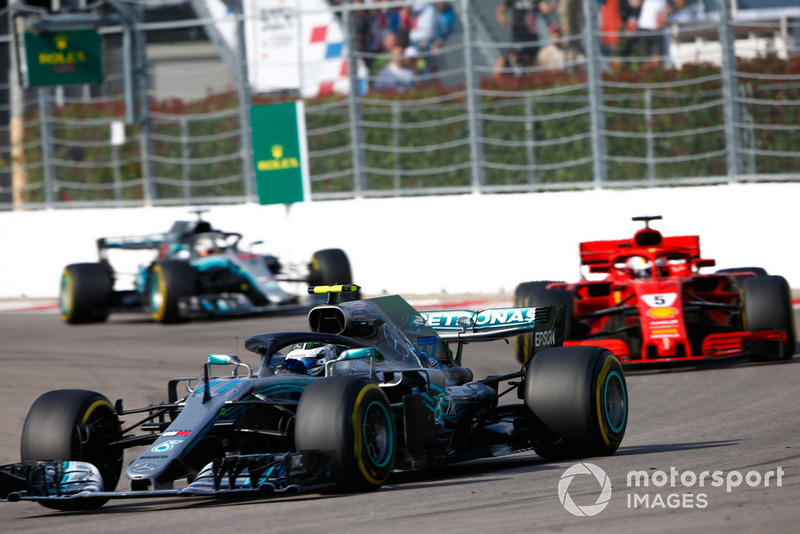 Valtteri Bottas, Mercedes AMG F1 W09, leads Sebastian Vettel, Ferrari SF71H, and Lewis Hamilton, Mercedes AMG F1 W09