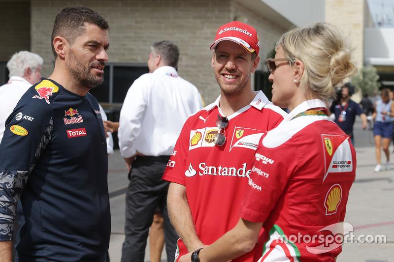 (L to R): Guillaume Rocquelin, Red Bull Racing Head of Race Engineering with Sebastian Vettel, Ferrari and Britta Roeske, Ferrari Press Officer